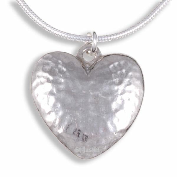 Beaten heart pendant on snake chain