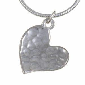 Heartbeat – tiny beaten heart pendant