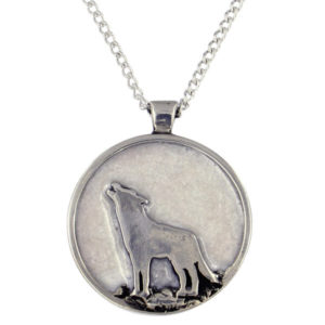 "St Justin - Wolf and enamelled moon pendant - a very eye catching pewter wolf pendant with enamelled moon in the background. Hangs on an 18"" rhodium-plated trace chain."