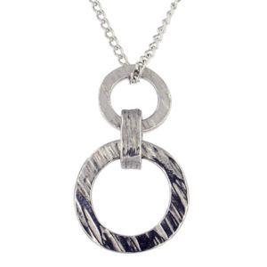 St Justin - Ridged double loop pendant - a ridged effect pewter pendant on an 18″ tin-plated or surgical steel curb chain.