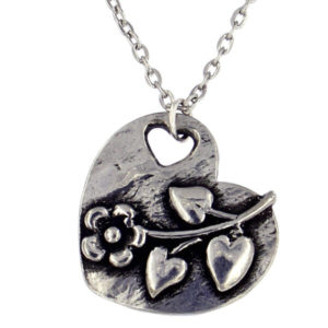 "St Justin - Flower heart pendant - a lovely pewter heart pendant with a raised flower design. Comes on an 18"" rhodium-plated trace chain."